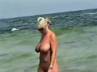 Voyeur At The Nudist Beach